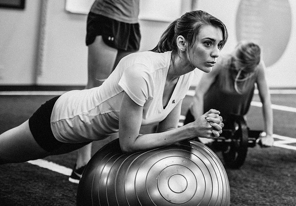 Female on a Balance Ball in Fitter female Gym
